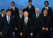 Russian President Vladimir Putin prepares to pose for a family photo during the Shanghai Cooperation Organization (SCO) summit, in Bishkek, Kyrgyzstan. Kyrgyz President Sooronbay Jeenbekov, is at left, and Pakistani Prime Minister Imran Khan, is at right