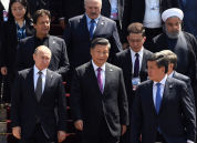 From in the 1st row, Russian President Vladimir Putin, Chinese President Xi Jinping, Kyrgyz President Sooronbay Jeenbekov and from left 2nd row, Pakistani Prime Minister Imran Khan, Belarusian President Alexander Lukashenko and Iranian President Hassan Rouhani walk before posing for a family photo during the Shanghai Cooperation Organization (SCO) summit, in Bishkek, Kyrgyzstan