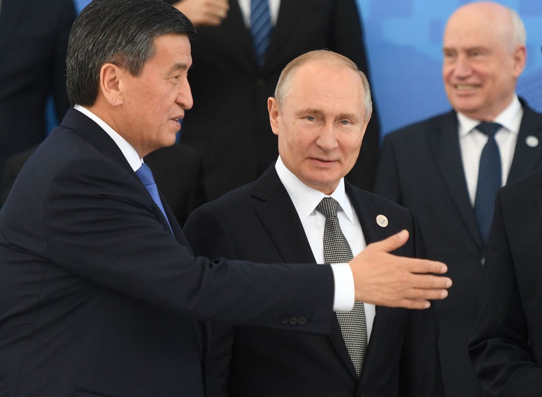 Kyrgyz President Sooronbay Jeenbekov, left, and Russian President Vladimir Putin prepare to pose for a family photo during the Shanghai Cooperation Organization (SCO) summit, in Bishkek, Kyrgyzstan