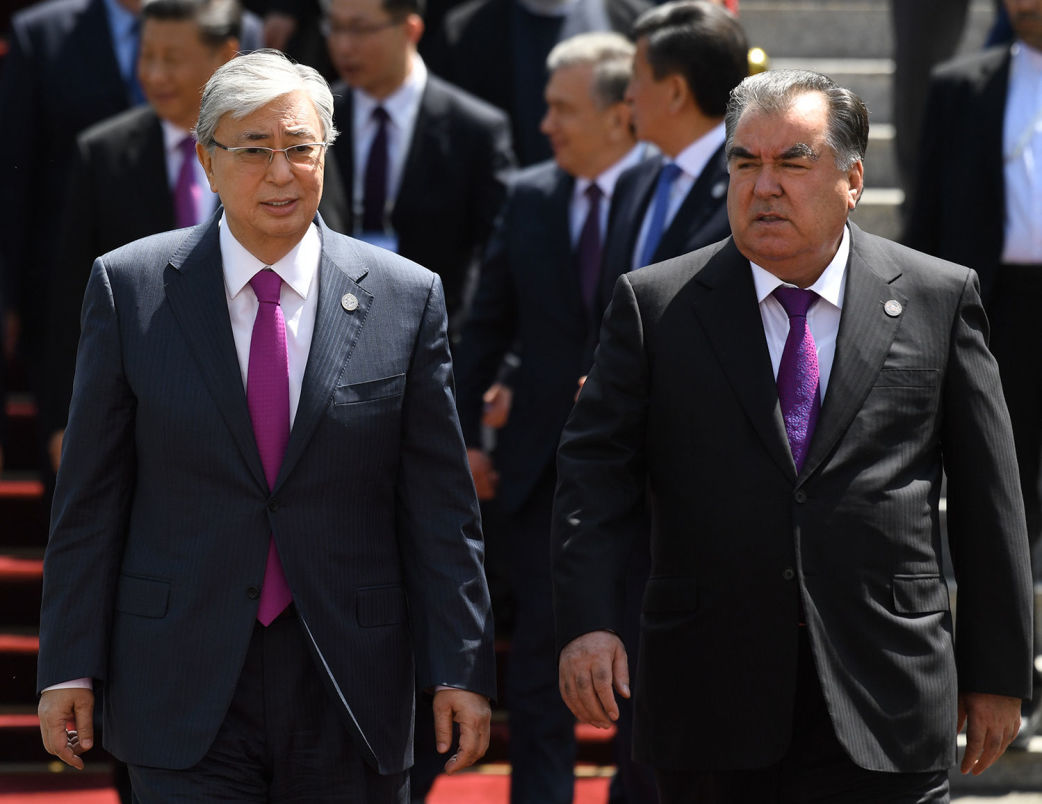 Kazakh President Kassym-Jomart Tokayev, left, and Tajik President Emomali Rahmon pose for a family photo during the Shanghai Cooperation Organization Summit, in Bishkek, Kyrgyzstan