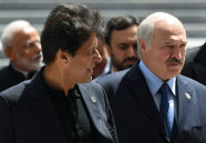 Pakistani Prime Minister Imran Khan, left, and Belarusian President Alexander Lukashenko arrive for posing for a family photo during the Shanghai Cooperation Organization (SCO) summit, in Bishkek, Kyrgyzstan